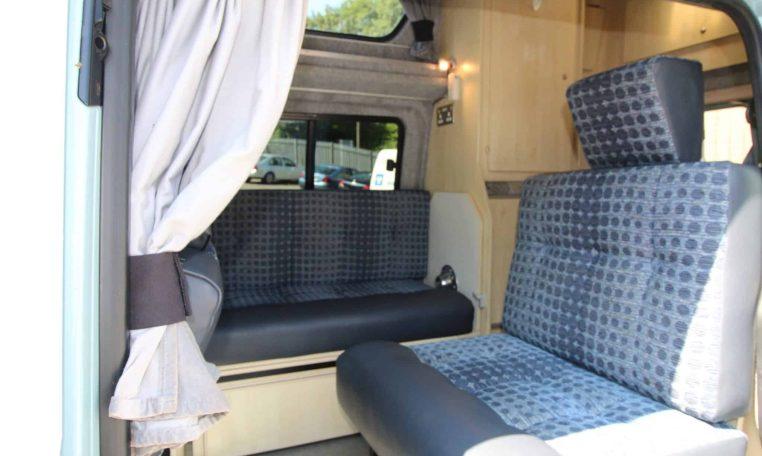 interior of VW Leisuredrive Vivante Campervan with door open