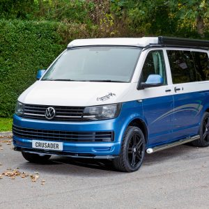 blue and white campervan for sale